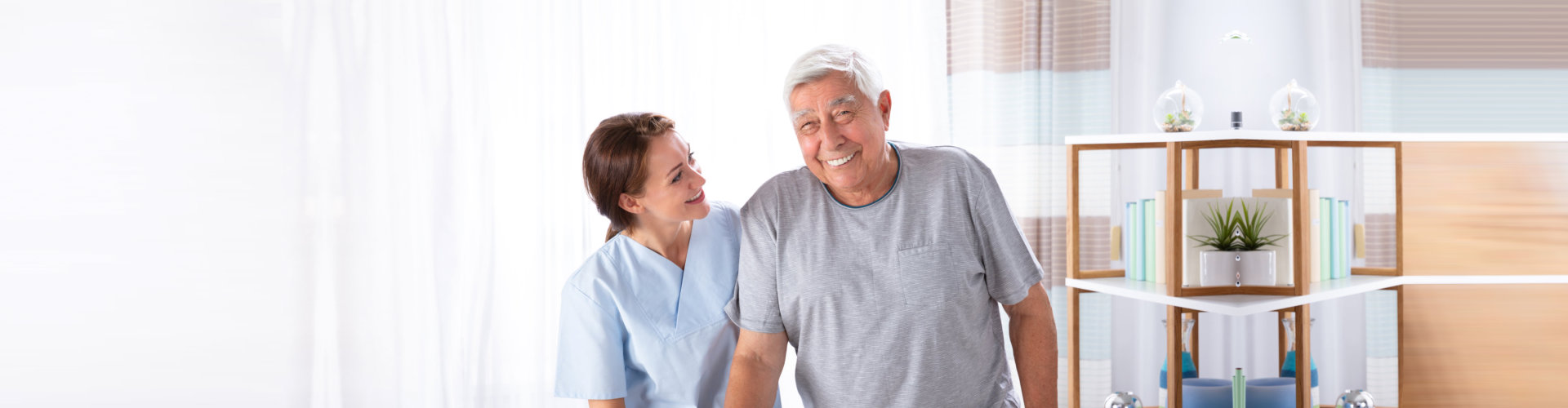 staff and elderly man smiling