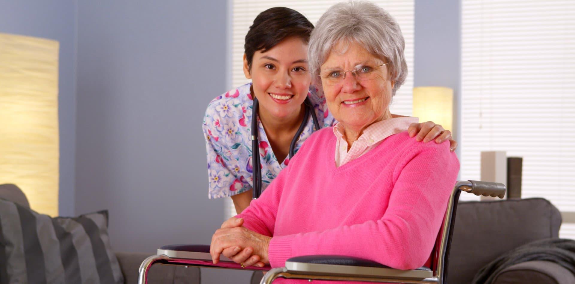 elderly woman on wheelchair and staff