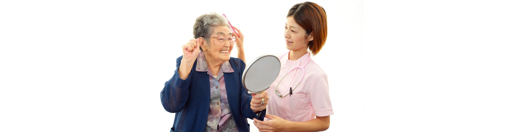 caregiver assisting senior woman taking care of her hai