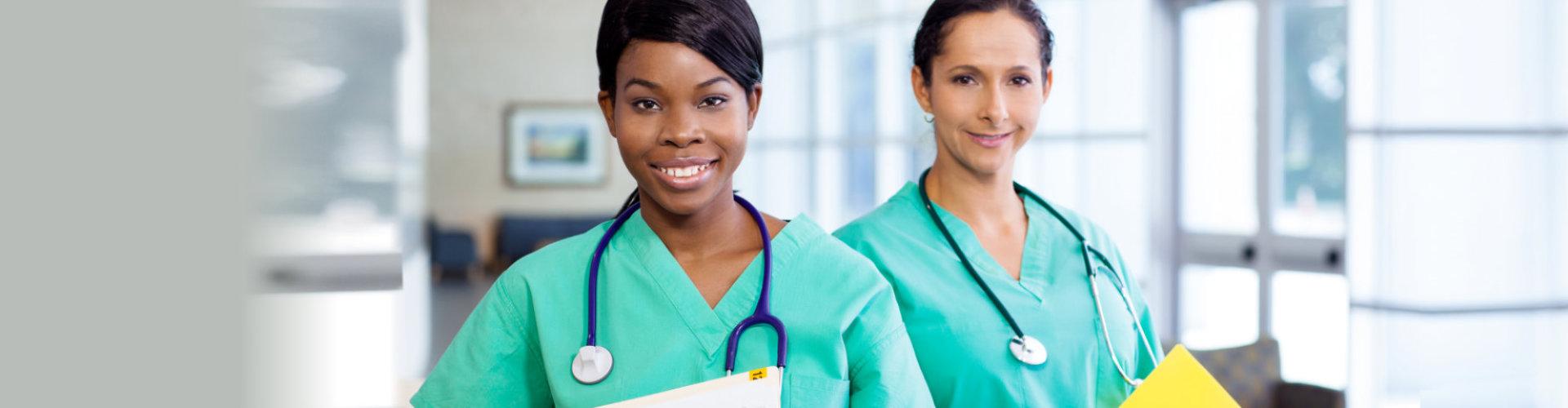 female nurses wearing stethoscopes smiling