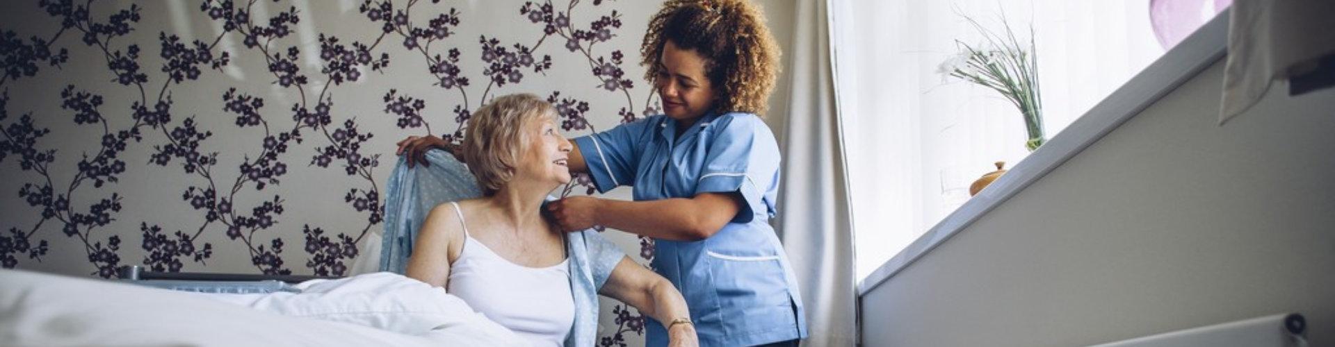 staff assisting elderly woman