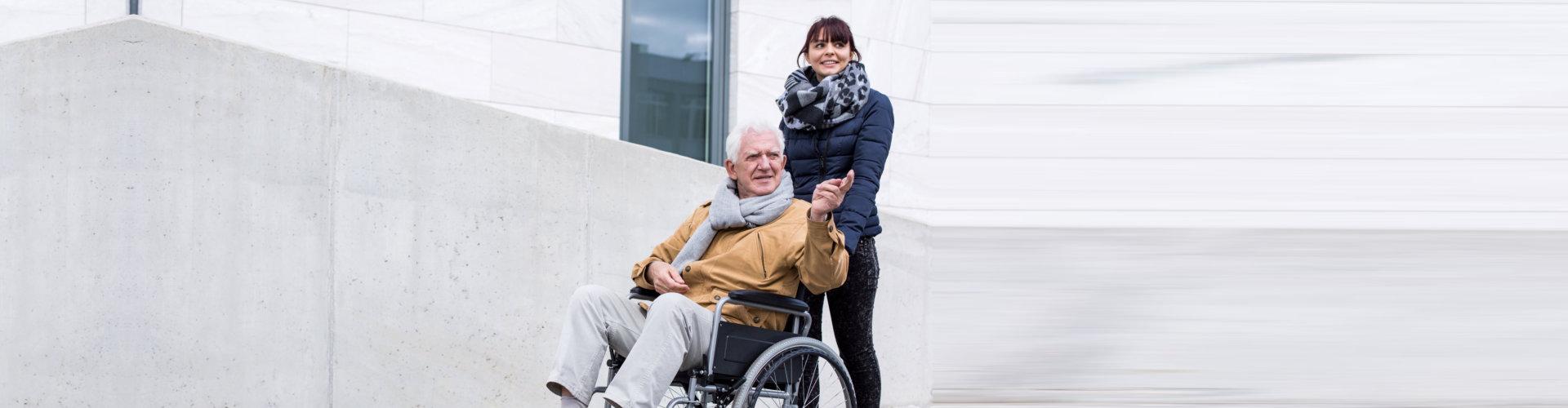 elderly man on wheelchair and staff